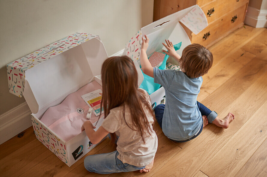 TWo kids opening Boxes of YAY!